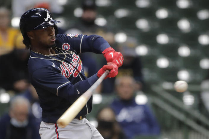 Atlanta Braves' Ozzie Albies hits an RBI double during the first inning of a baseball game against the Milwaukee Brewers Saturday, May 15, 2021, in Milwaukee. (AP Photo/Aaron Gash)