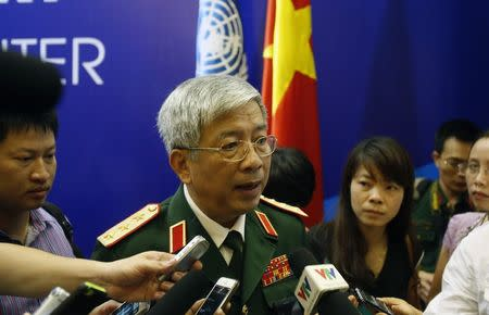 Vietnam's Deputy Defence Minister General Nguyen Chi Vinh (C) speaks with the media after the inauguration ceremony of Vietnam Peace Keeping Center in Hanoi May 27, 2014. REUTERS/Kham