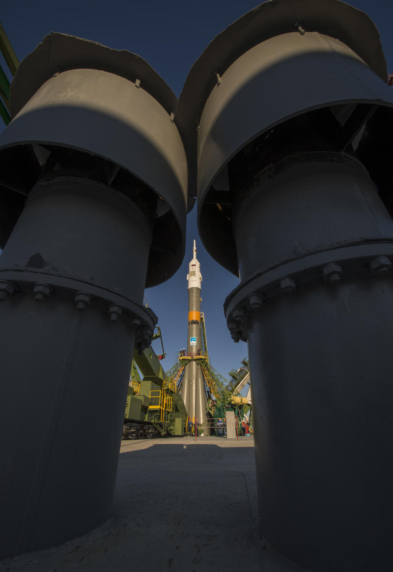 The Soyuz rocket is erected into position after being rolled out to the launch pad by train, on Sunday, Oct. 21, 2012, at the Baikonur Cosmodrome in Kazakhstan. NASA's Kevin Ford and Russian astronauts Oleg Novitsky and Yevgeny Tarelkin will blast off Tuesday, Oct. 23, 2012,  from the Russian-leased facility in southern Kazakhstan and will spend around six months on the orbiting laboratory. They will join U.S. astronaut Sunita Williams, Russia's Yuri Malenchenko and Aki Hoshide of Japan's JAXA agency. (AP Photo/NASA, Bill Ingalls) MANDATORY CREDIT