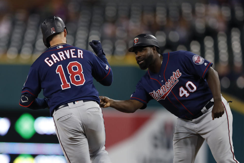 Minnesota Twins' Mitch Garver is greeted by first base coach Tommy Watkins after a solo home run during the ninth inning of a baseball game Saturday, Aug. 31, 2019, in Detroit. Garver's home run was the Twins 268th home run of this season, a MLB record for most home runs by a team in a single season. (AP Photo/Carlos Osorio)