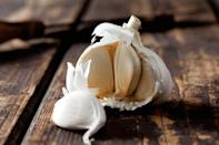 <p>Like onions, garlic is best kept in a cool, dry place. Refrigeration causes it to become rubbery.</p>