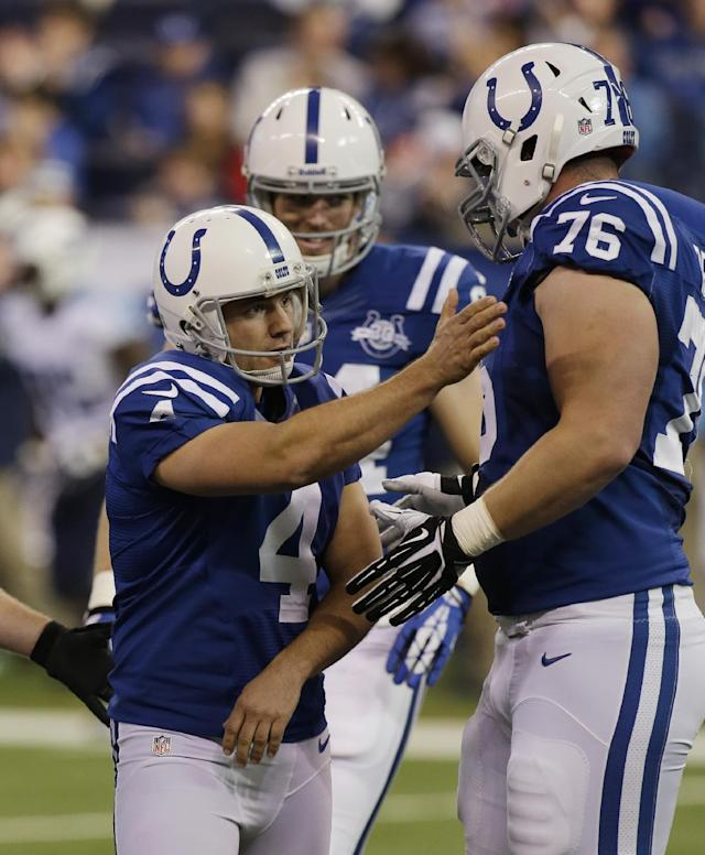 Indianapolis Colts' Adam Vinatieri (4) celebrates with Joe Reitz (76) after Vinatieri kicked a 37-yard field goal during the first half of an NFL football game against the Tennessee Titans on Sunday, Dec. 1, 2013, in Indianapolis. (AP Photo/AJ Mast)