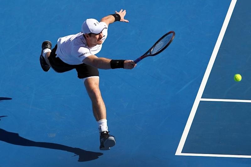 Britain's Andy Murray returns the ball to Canada's Milos Raonic during the third-place match at the Mubadala World Tennis Championship 2016 in Abu Dhabi on December 31, 2016