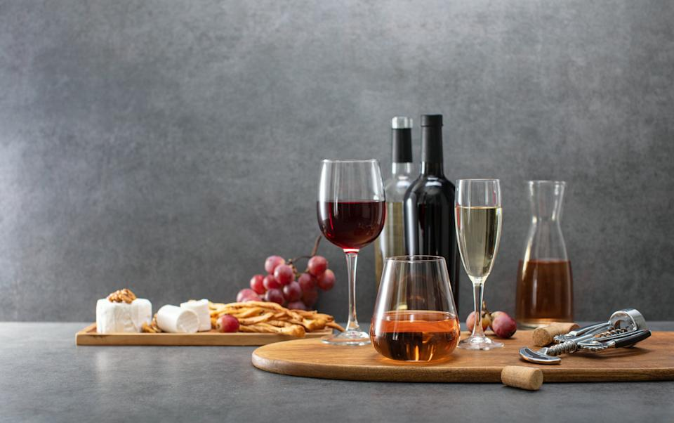 Front view of wine bottles and wine glasses ready for tasting with gourmet snacks, wine sale leaflet template