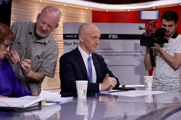 Former Trump campaign advisor Carter Page, who was suspected but never charged over questionable ties to Russia during the 2016 campaign, is seen (C) ahead of a May 29, 2019 appearance on the One America News Network (AFP Photo/CHIP SOMODEVILLA)
