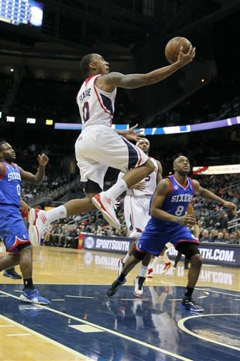 Atlanta Hawks point guard Jeff Teague (0) leaps for a shot in first-half action of an NBA basketball game against the Philadelphia 76ers, Wednesday, March 6, 2013, in Atlanta. The Hawks won the game 107-96. (AP Photo/Todd Kirkland)