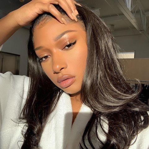 """<p>Glowy skin, simple makeup, nude nails, and wavy hair make this our kind of night-in look.</p><p><a href=""""https://www.instagram.com/p/CI9MDxGlu6a/"""" rel=""""nofollow noopener"""" target=""""_blank"""" data-ylk=""""slk:See the original post on Instagram"""" class=""""link rapid-noclick-resp"""">See the original post on Instagram</a></p>"""
