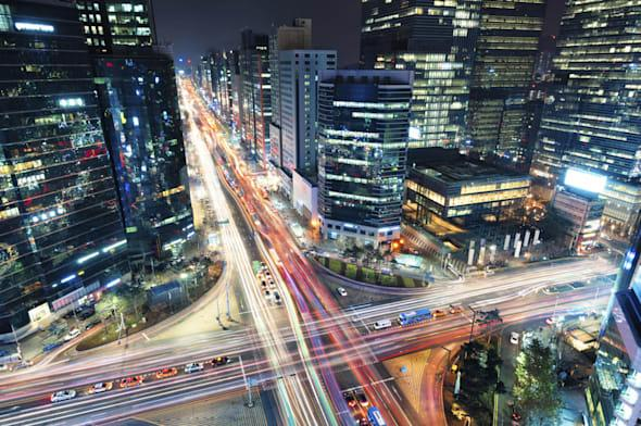 Night traffic speeds through the Gangnam district of Seoul, South Korea.