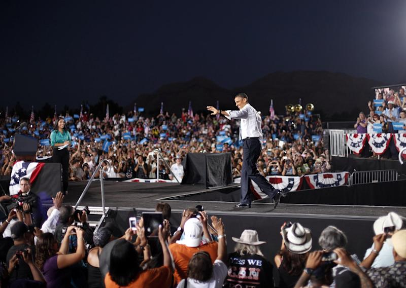 President Barack Obama walks on stage during a campaign event at Desert Pines High School, Sunday, Sept. 30, 2012 in Las Vegas. (AP Photo/Pablo Martinez Monsivais)