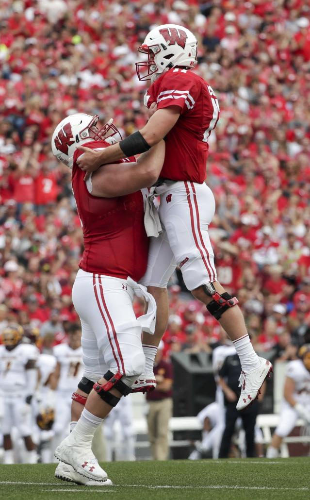 Wisconsin's Jack Coan celebrates a touchdown with Tyler Biadasz during the first half of an NCAA college football game against Central Michigan Saturday, Sept. 7, 2019, in Madison, Wis. (AP Photo/Morry Gash)