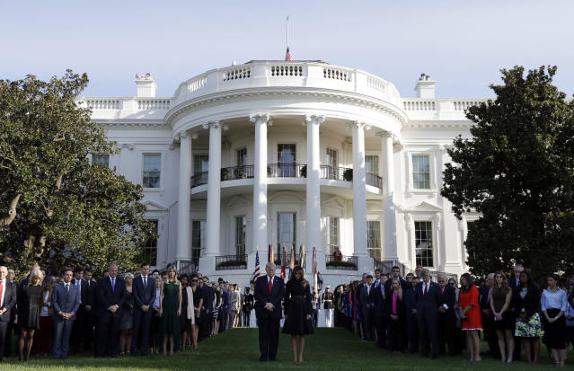 <p>President Trump and first lady Melania Trump stand for a moment of silence to mark the anniversary of the Sept. 11 terrorist attacks, on the South Lawn of the White House, Monday, Sept. 11, 2017, in Washington. (Photo: Evan Vucci/AP) </p>