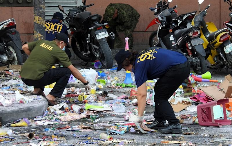 Scattered debris including items traditionally sold for New Year celebrations, such as cardboard and plastic horns and gifts, as well as a bloody slipper, lay at the mall's entrance where the explosion took place (AFP Photo/-)