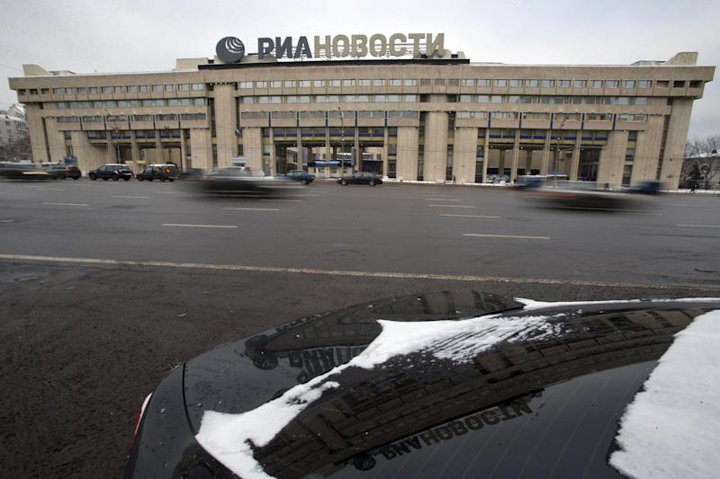 Cars pass by the former Russian RIA Novosti information agency headquarters in Moscow, Russia, Monday, Dec. 9, 2013. President Vladimir Putin has appointed Dmitry Kiselyov, a controversial news anchor known for his ultraconservative views, to head a newly restructured state news agency on Monday, Dec. 9, 2013. The decree, which effectively transferred all property of RIA Novosti to Russia Today, was effective immediately. The chief can be appointed or dismissed directly by Putin.(AP Photo/Pavel Golovkin)