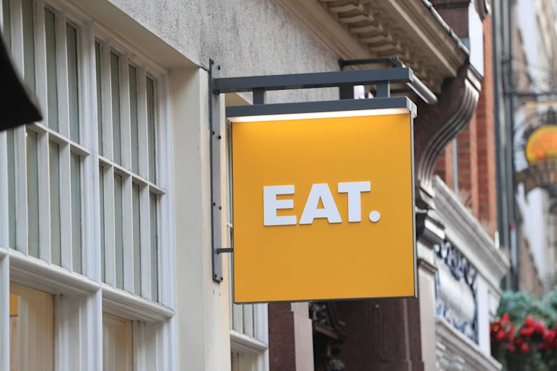 A view of a sign for an EAT. sandwich shop in London.