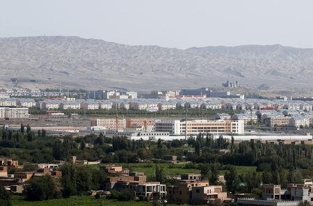 FILE PHOTO: With Xinjiang's fabled Tianshan mountains in the background, what is officially known as a vocational skills education centre is seen in Turpan in Xinjiang Uighur Autonomous Region, China September 5, 2018. REUTERS/Thomas Peter