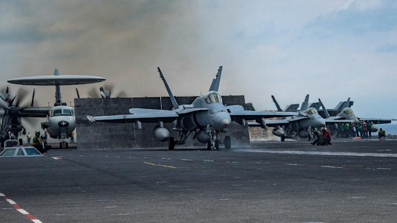 An F/A-18C Hornet prepares to launch from the USS Carl Vinson this month (AFP Photo/MCSA Jake  CANNADY)