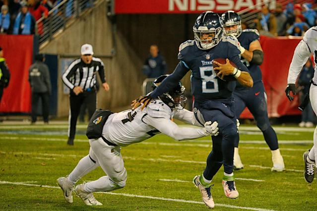 "Titans quarterback <a class=""link rapid-noclick-resp"" href=""/nfl/players/28390/"" data-ylk=""slk:Marcus Mariota"">Marcus Mariota</a> wore five different cleats on Thursday that were designed by students from a Washington high school. (Photo by Frederick Breedon/Getty Images)"