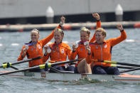 Silver medalists Ellen Hogerwerf, Karolien Florijn, Ymkje Clevering and Veronique Meester of Netherlands pose for photographers after a medal ceremony for the women's rowing four final at the 2020 Summer Olympics, Wednesday, July 28, 2021, in Tokyo, Japan. (AP Photo/Lee Jin-man)