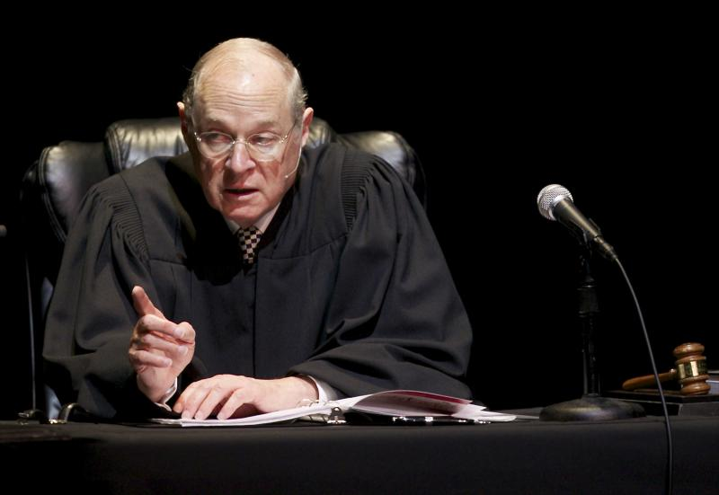 """FILE - In this Jan. 31, 2011, file photo U.S. Supreme Court Justice Anthony Kennedy presides over a representation of """"The Trial of Hamlet"""" at the Shakespeare Center of Los Angeles. During Supreme Courts arguments last week over the constitutionality of the health care law Justice Kennedy mused that Congress could have created a Medicare-style program for the uninsured, run exclusively by the government without the involvement of private insurers.  (AP Photo/Damian Dovarganes, File)"""