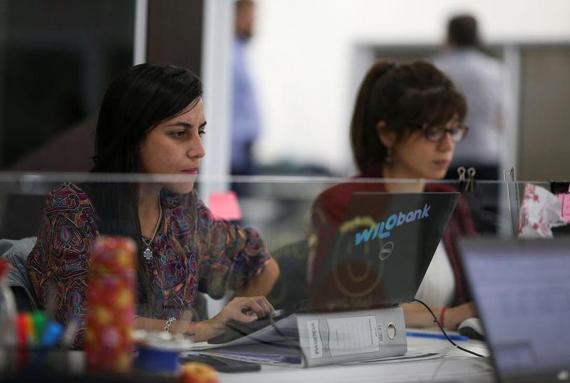 Employees work at the Wilobank offices, in Buenos Aires