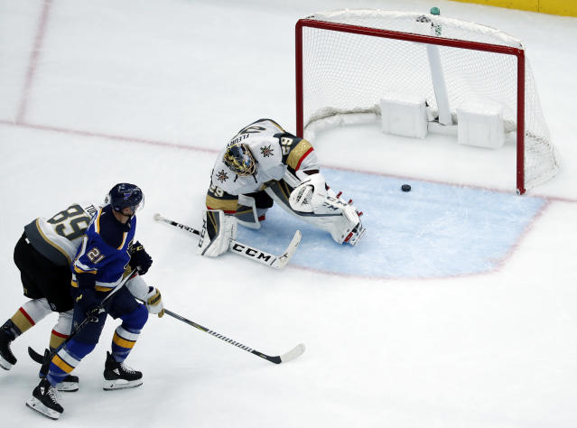 St. Louis Blues' Tyler Bozak (21) scores past Vegas Golden Knights' Alex Tuch (89) and goaltender Marc-Andre Fleury (29) during the third period of an NHL hockey game Thursday, Nov. 1, 2018, in St. Louis. The Blues won 5-3. (AP Photo/Jeff Roberson)