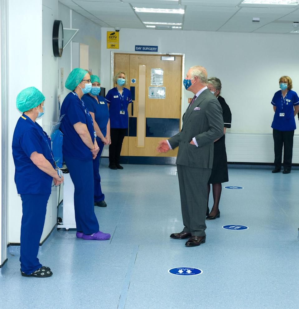 Charles chats to the day surgery team during his visit (Henry Arden/PA)