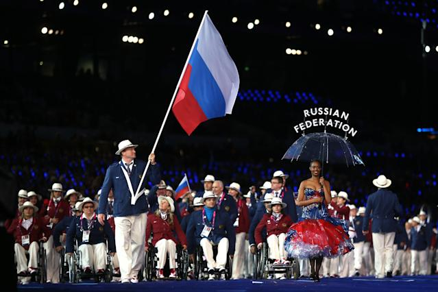 LONDON, ENGLAND - AUGUST 29: Athlete Alexey Ashapatov of Russia carries the flag during the Opening Ceremony of the London 2012 Paralympics at the Olympic Stadium on August 29, 2012 in London, England. (Photo by Clive Rose/Getty Images)