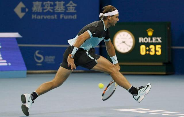 Nadal hits a return backwards to Djokovic during the men's singles final match at the China Open Tennis Tournament in Beijing