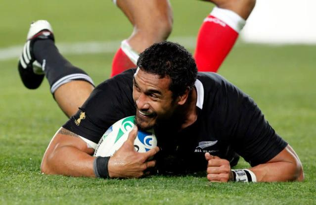 FILE PHOTO: New Zealand All Blacks' Jerome Kaino smiles after scoring a try against Tonga during their Rugby World Cup Pool A match at Eden Park in Auckland