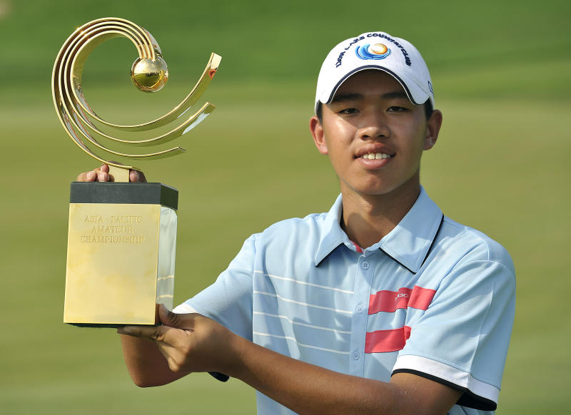 Guan Tianlang of China poses with the winner's trophy at the Asia-Pacific Amateur Championship at Amata Spring Country Club, in Chonburi, Thailand Sunday, Nov. 4, 2012. (AP Photo/AAC, Paul Lakatos) NO LICENSING