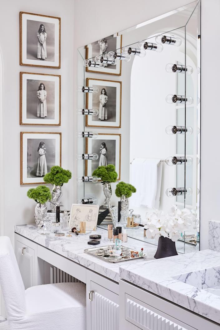 """The vanity in Rivers's glam area features some of her most favorite possessions, including a drawing her mother did of Melissa and her son Cooper sitting on the beach during a family vacation, and silver fish vases a friend brought her back from Portugal. The three black-and-white photos hanging on the wall are of Melissa when she was around four years old. """"My father had asked their good friend, photographer Kenn Duncan, to take these. They were either a Mother's Day or birthday gift from my father to my mother."""""""