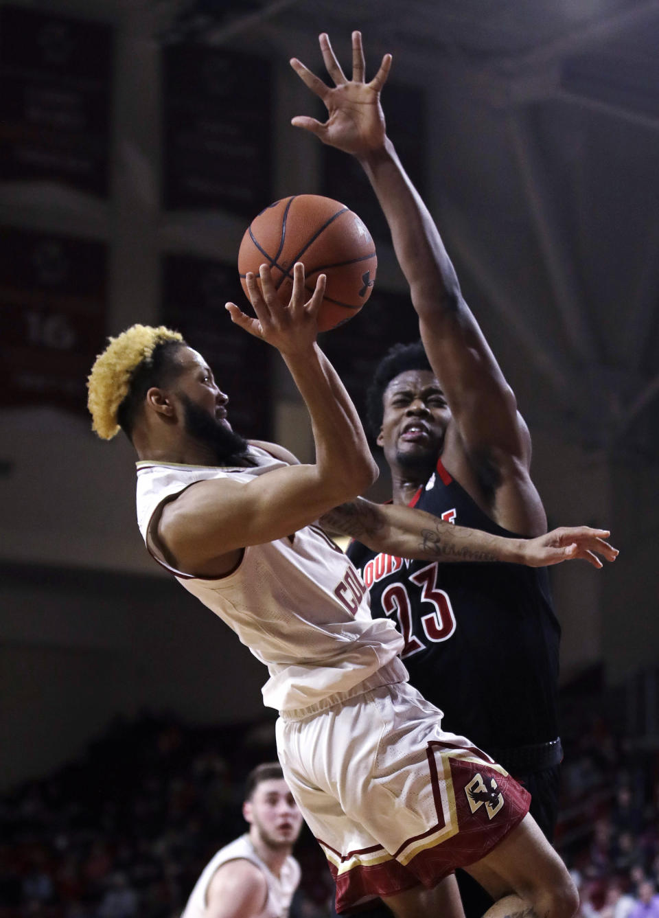 Boston College guard Ky Bowman, left, shoots as Louisville center Steven Enoch (23) defends during the second half of an NCAA college basketball game in Boston, Wednesday, Feb. 27, 2019. (AP Photo/Charles Krupa)
