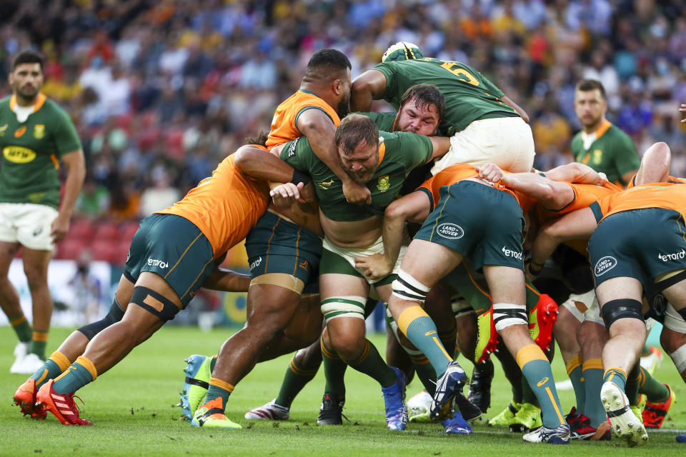 South Africa's Duane Vermeulen, centre, leads his forwards during the Rugby Championship test match between the Springboks and the Wallabies in Brisbane, Australia, Saturday, Sept. 18, 2021. (AP Photo/Tertius Pickard)