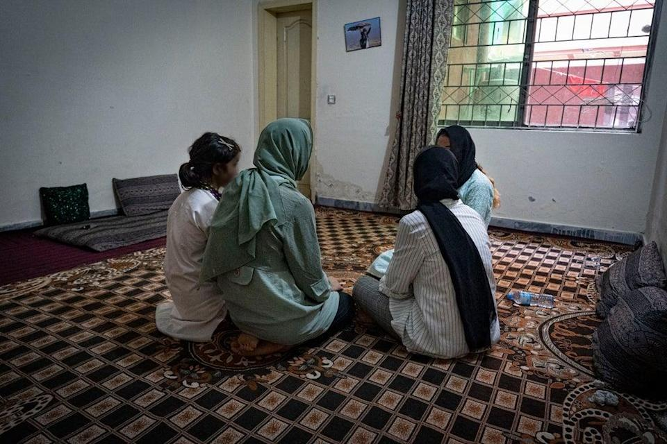 Sima and her sisters in an apartment block outside Islamabad (Bel Trew)
