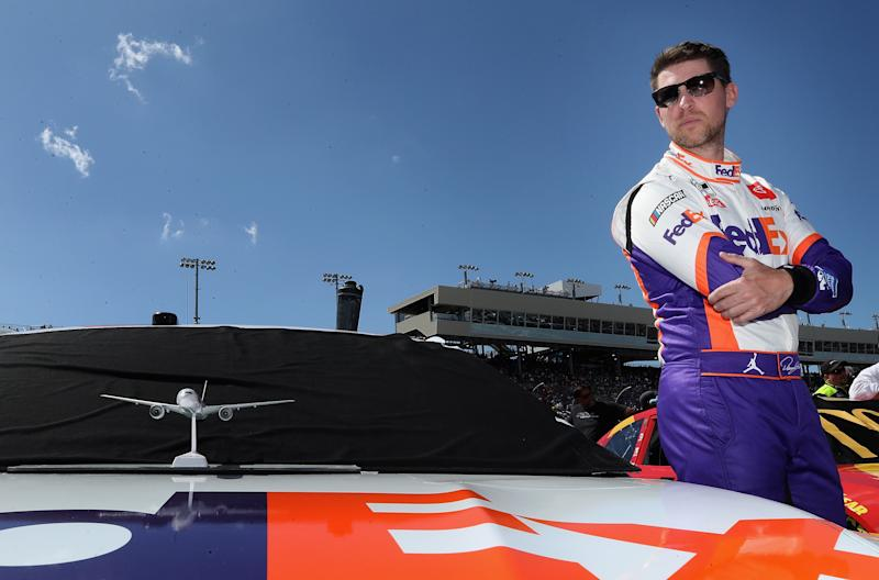 AVONDALE, ARIZONA - MARCH 08: Denny Hamlin, driver of the #11 FedEx Freight Toyota, stands on the grid before the NASCAR Cup Series FanShield 500 at Phoenix Raceway on March 08, 2020 in Avondale, Arizona. (Photo by Christian Petersen/Getty Images)