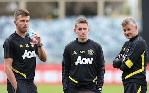 Coach Michael Carrick (left), coach Kieran McKenna (centre) and Manager Ole Gunnar Solskjaer (right) - Credit: getty images
