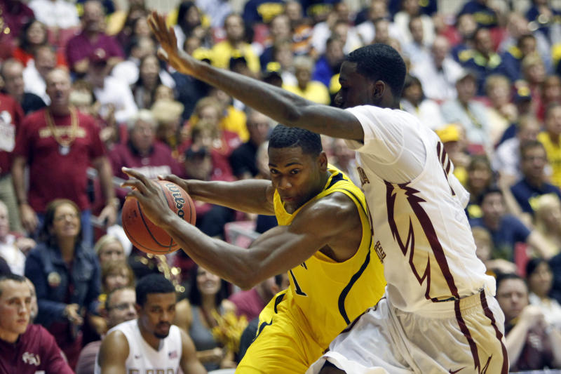 No. 14 Michigan overcomes Florida St 82-80 in OT