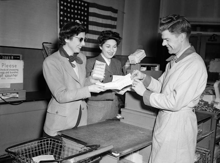 """<p>During WWII, <a href=""""https://www.livescience.com/3643-valuable-wwii-ration-coupons.html"""" rel=""""nofollow noopener"""" target=""""_blank"""" data-ylk=""""slk:ration coupons"""" class=""""link rapid-noclick-resp"""">ration coupons</a>, like the ones seen here, were used for families to buy sugar, gas, coffee and milk.</p>"""
