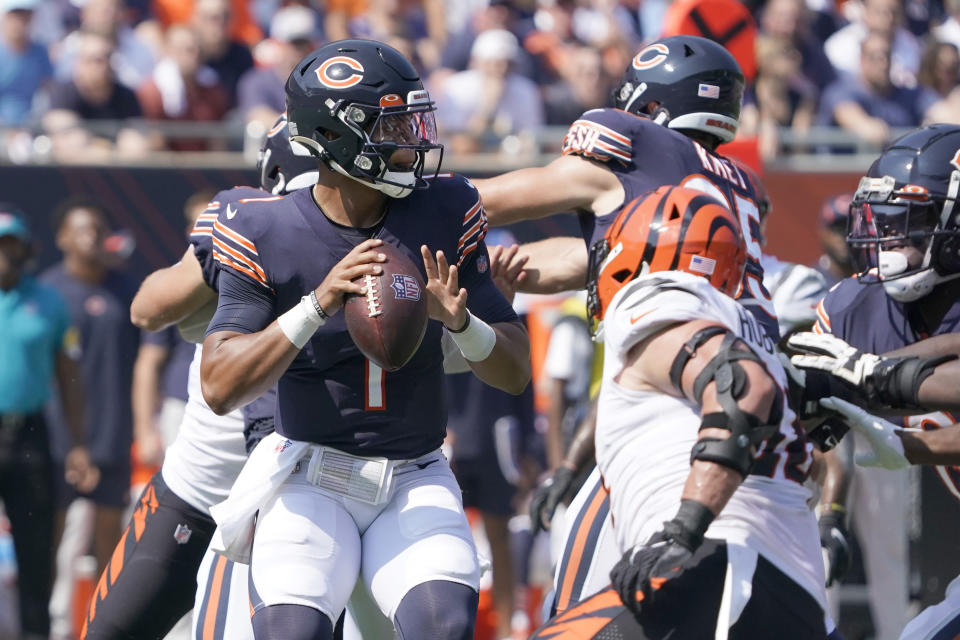 Chicago Bears quarterback Justin Fields looks to pass during the first half of an NFL football game against the Cincinnati Bengals Sunday, Sept. 19, 2021, in Chicago. (AP Photo/David Banks)