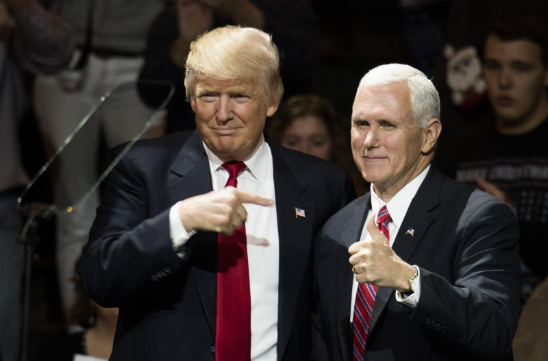 President-elect Donald Trump and Vice President-elect Mike Pence stand onstage together at U.S. Bank Arena on December 1, 2016 in Cincinnati, Ohio. (Photo by Ty Wright/Getty Images)