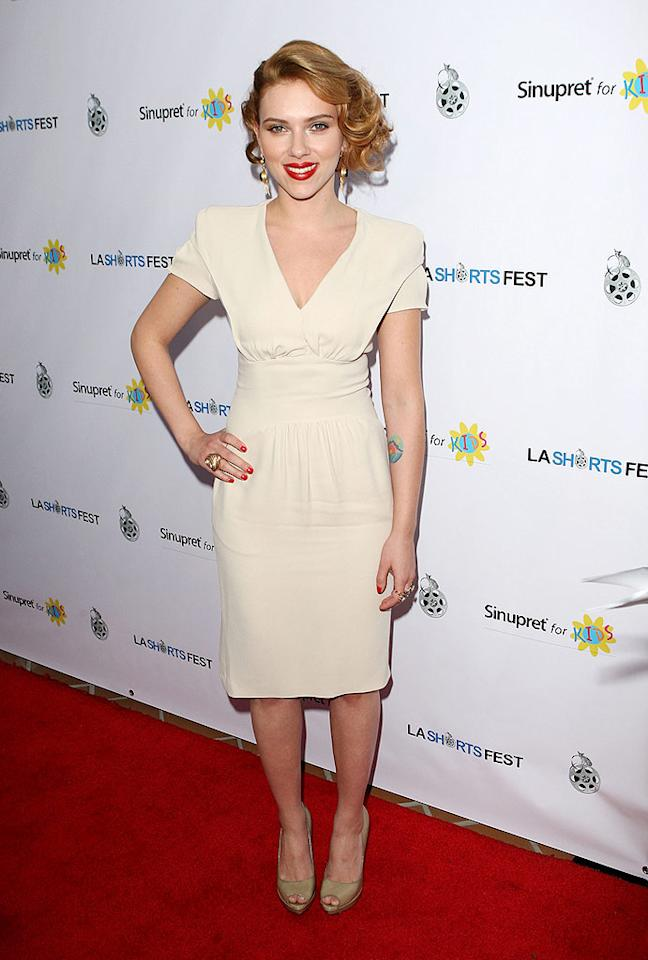 """Speaking of channeling an icon, Scarlett Johansson did just that when she arrived at the LA Short Film Festival looking like Grace Kelly in a chic and sophisticated Prada frock and nude heels. Jason Merritt/<a href=""""http://www.gettyimages.com/"""" target=""""new"""">GettyImages.com</a> - July 23, 2009"""