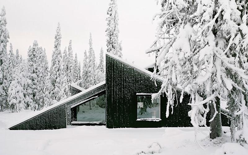 The striking slanted roofs of Cabin Vindheim serve as slopes for skiing, sledding and other snow-based activities - All rights reserved by photographer