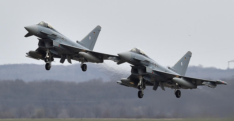 FILE - In this March 21, 2016 file photo, two Eurofighter jets perform at the German Air Force Base in Noervenich, western Germany. Two German Eurofighter military planes crashed today near the city of Jabel in eastern Germany. (AP Photo/Martin Meissner)