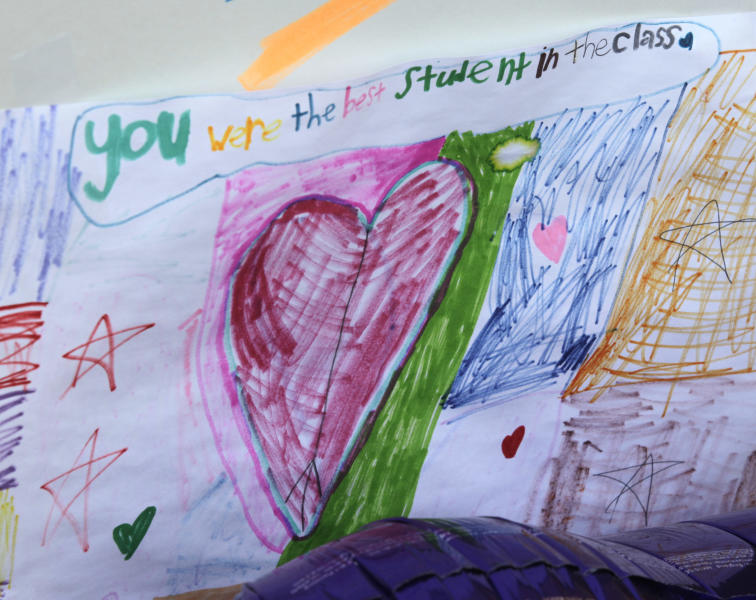 A child's drawing in tribute to Charlie Powell is shown posted at a growing memorial to Charlie and Braden Powell, Tuesday, Feb. 7, 2012, at Carson Elementary School in Puyallup, Wash., where Charlie attended school. Charlie and Braden were killed Sunday, along with their father, Josh Powell, in what police said appeared to be a deliberately set fire by Powell at a home in Graham, Wash. (AP Photo/Ted S. Warren)