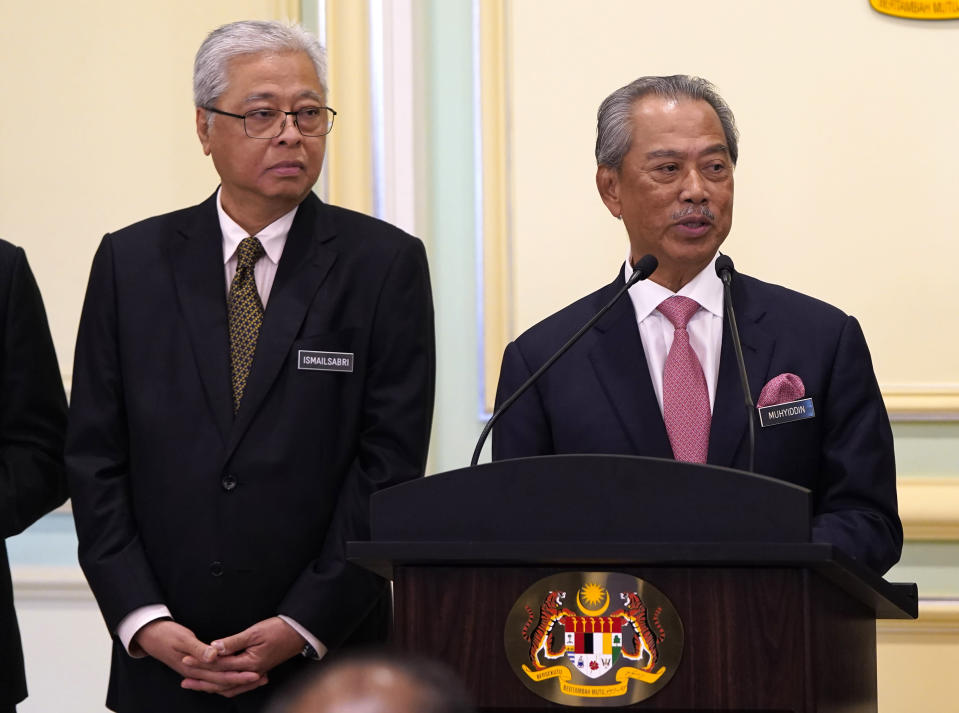 In this picture taken Wednesday, May 11, 2020, Malaysia's Prime Minister Muhyiddin Yassin, right, and Defense Minister Ismail Sabri Yaakob attend a press conference in the Prime Minister's office in Putrajaya, Malaysia. Muhyiddin has appointed Ismail as his deputy, in a calculated bid to dissuade the party from withdrawing support for his leadership. (AP Photo/Vincent Thian)