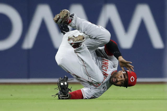 Cincinnati Reds left fielder Matt Kemp falls after making the catch for the out on San Diego Padres' Franmil Reyes during the fifth inning of a baseball game Thursday, April 18, 2019, in San Diego. (AP Photo/Gregory Bull)