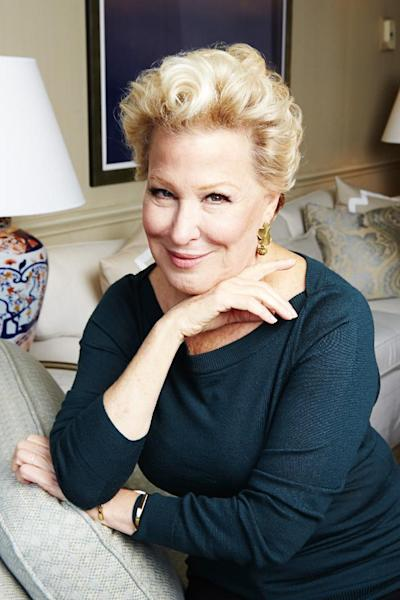 "FILE - In this Oct. 7, 2014 file photo, Bette Midler poses for a portrait in New York. The Grammy- and Emmy Award-winner is re-releasing a deluxe version of ""The Divine Miss M,"" her 1972 debut album that included the hits ""Do You Want To Dance,"" ""Chapel Of Love,"" ""Friends"" and ""Boogie Woogie Bugle Boy."" (Photo by Dan Hallman/Invision/AP, File)"