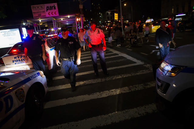 <p>Members of NYPD shut down streets before a fireworks display over the East River, Tuesday, July 4, 2017, in New York. (AP Photo/Michael Noble Jr.)<br></p>