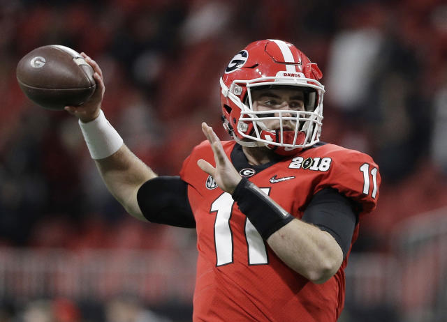 "FILE - In this Jan. 8, 2018, file photo, Georgia's Jake Fromm warms up before the NCAA college football playoff championship game against Alabama, in Atlanta. Georgia quarterback Jake Fromm has a broken bone in his left hand but isn't expected to miss any summer workouts. School athletics spokesman Leland Barrow said Thursday that Fromm has a ""small fracture"" in his non-throwing hand, though he is already throwing the football. Barrow didn't have details on how Fromm was injured, while coach Kirby Smart told ESPN on Wednesday, July 4, 2018, that the injury happened earlier this week. (AP Photo/David J. Phillip, File)"