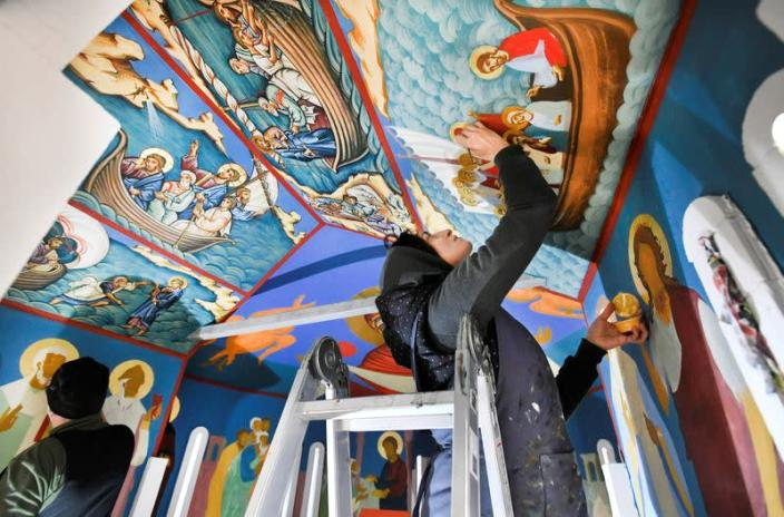 Georgian restorers work on frescoes at the chapel of a mobile Georgian Orthodox monastery in Vlissingen